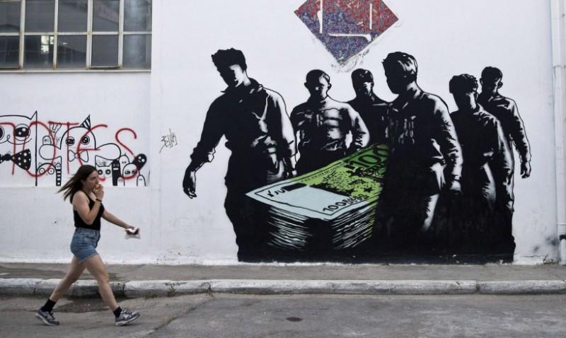 """Смерть евро..."" Фото: Petros Giannakouris / AP / SIPA"