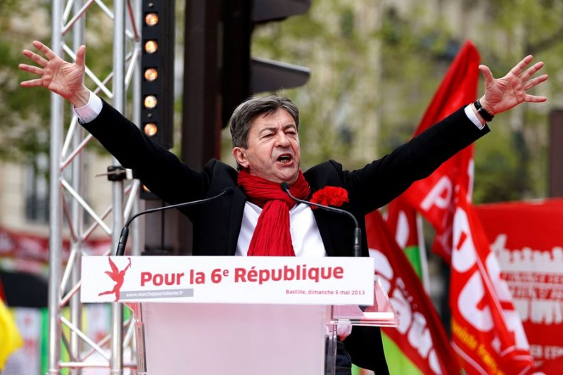 """French far-left Parti de Gauche (PG) leader Jean-Luc Melenchon delivers a speech during a demonstration in Paris, May 5, 2013. The far-leftist Parti de Gauche called for a demonstration on Sunday against austerity and for the establishment of a """"sixth republic"""", which includes diminishing the power of the president and increasing the parliament's authority, on the eve of the first anniversary of the election of French President Francois Hollande. The slogan on the podium reads, """"For the sixth republic"""". REUTERS/Charles Platiau (FRANCE - Tags: POLITICS CIVIL UNREST BUSINESS)"""