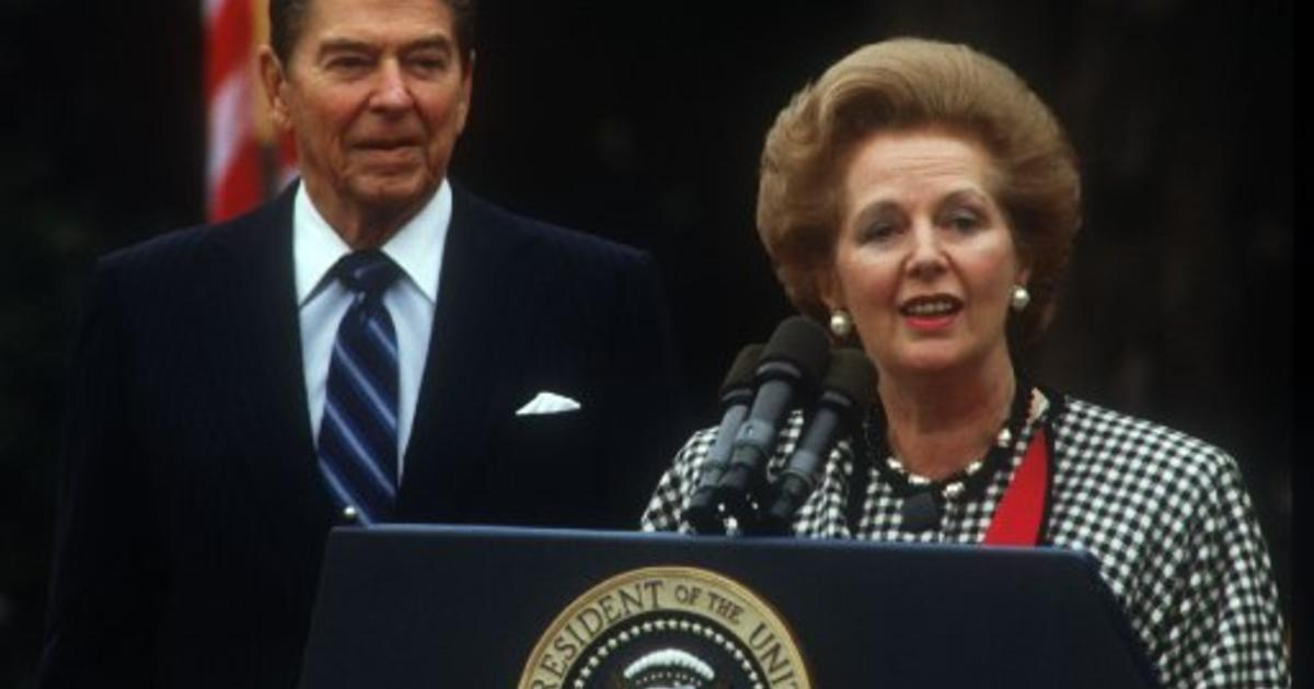 1988: (FILE PHOTO) Baroness Margaret Thatcher, 85, Britain's Prime Minister from 1979 to 1990, Reports on April 8, 2013 state that Baroness Thatcher has died following a stroke.. President Ronald Reagan watches as British Prime Minister Margaret Thatcher speaks on November 16, 1988 in Washington, DC. Thatcher visits the White House to attend President Reagan's last state dinner. (Photo by Brad Markel/Liaison/Getty Images)