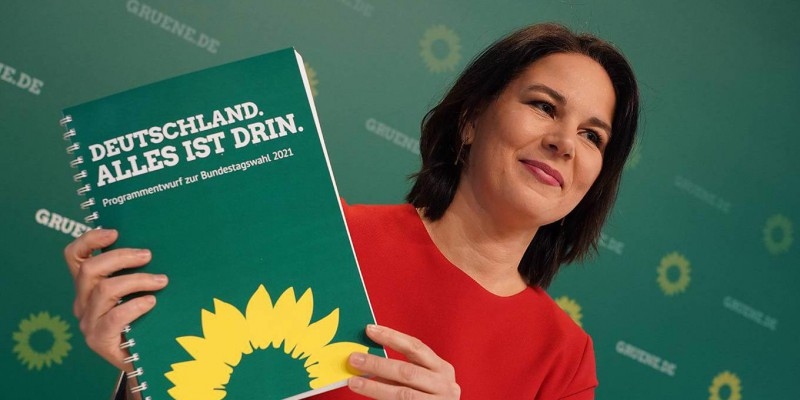 BERLIN, GERMANY - MARCH 19: Annalene Baerbock, co-leader of the German Greens Party, holds up a description of the party's policy program at a livestreamed, digital press conference ahead of Germany's federal elections scheduled for September on March 19, 2021 in Berlin, Germany. Polls show the Greens are currently the second-strongest party in Germany at 20%. The party had a strong showing in recent state elections in Rhineland-Palatinate and Baden-Wuerttemberg, where in both it is part of the ruling coalitions. (Photo by Sean Gallup/Getty Images)